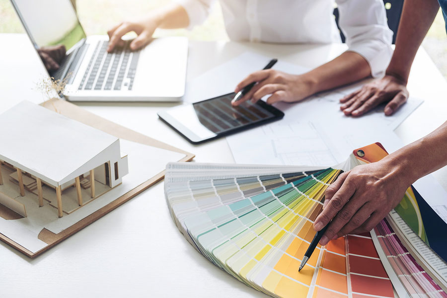 denver colorado home staging color consultation picking out colors on desk with lap top