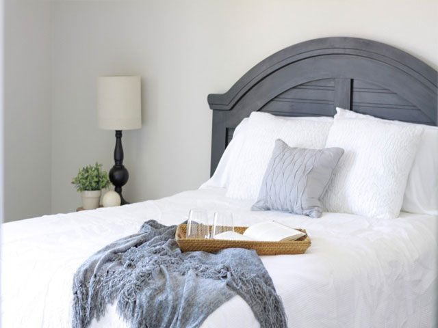 bedroom home staging in littleton colorado with white bedding and gray blanket
