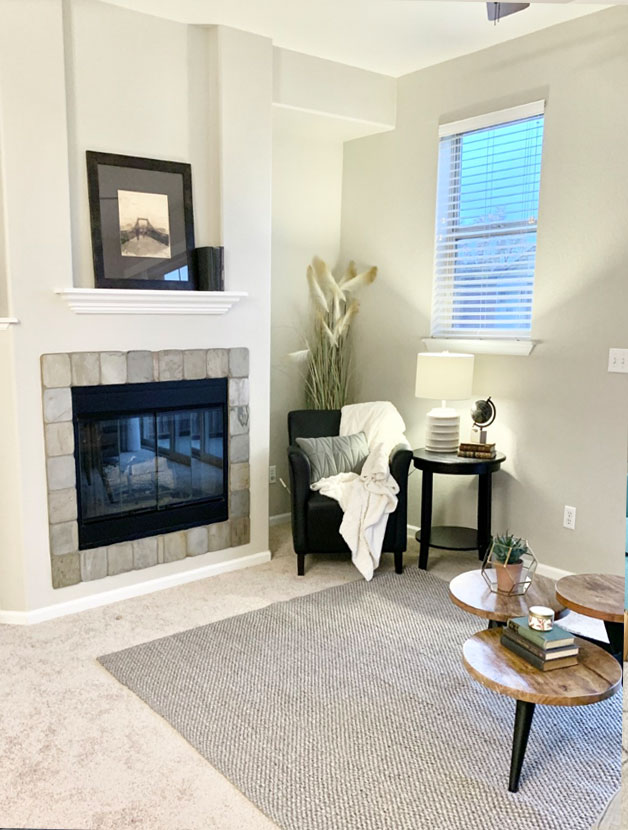 warm living room in littleton colorado with gas fireplace and sitting area
