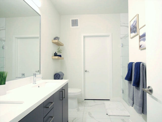 brightly lit clean bathroom interior with modern decor