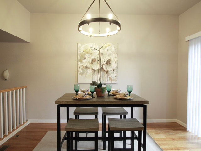 elegant and clean denver staging design of kitchen and sitting area