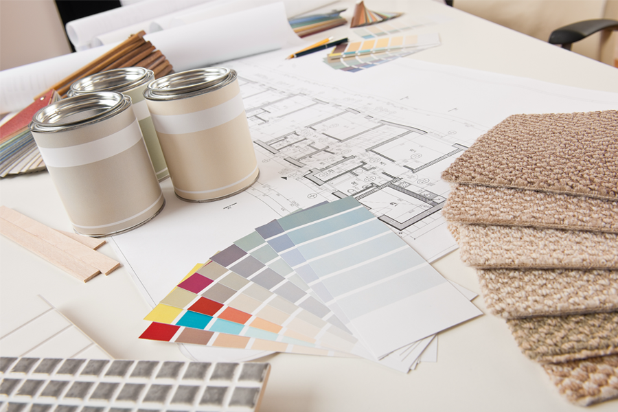 home staging color consultation with paint swatches and paints on desk
